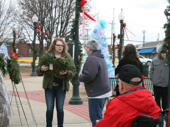 Heather Duggins of Bouquet Palace talks to Betty Evans, secretary of Kirby and Family Funeral and Cremation Services, as part of Saturday's Wreaths Across America event. A number of volunteers placed a number of wreaths at the Veterans Plaza and on veteran's graves at Kirby's Tucker Cemetery, Baxter Memorial Garden at Roller Funeral Home and Mountain Home Cemetery.