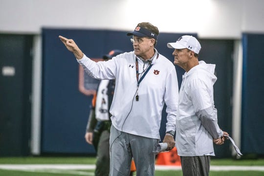 Auburn coach Gus Malzahn (left) and offensive coordinator Chad Morris (right) during Auburn's first bowl practice on Dec. 15, 2019, in Auburn, Ala.