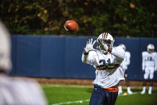 Auburn safety Smoke Monday catches a ball during bowl practice on Sunday, Dec. 15, in Auburn, Ala.