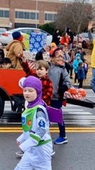Rowan Frensley, waving in red, participates in the Mt. Juliet Christmas parade on Saturday.