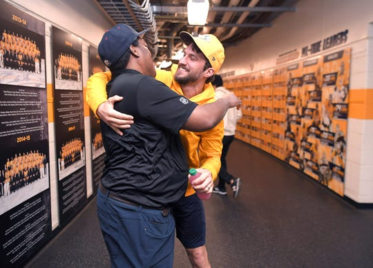 Predators hockey player and captain Roman Josi gives Craig Baugh a hug in the hallway of the Predators clubhouse at Bridgestone Arena on Tuesday, Dec. 10, 2019. Baugh has been with the Predators as a clubhouse assistant since they began the franchise.
