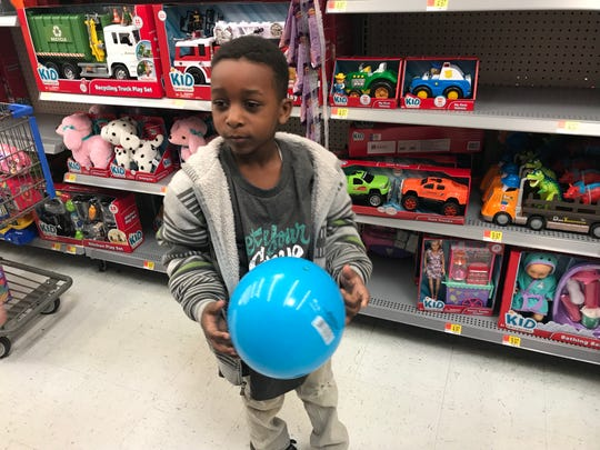 Josiah Calhoun, 5, strolls the toy aisle while looking for a Christmas gift for his sister.
