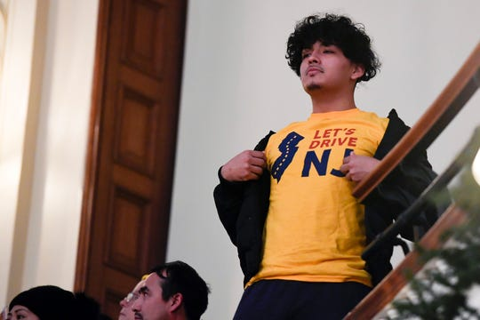 A supporter of the bill wears a ÒLetÕs Drive NJÓ shirt as the Assembly votes to pass the bill that will allow undocumented immigrants to obtain a driverÕs license on Monday, Dec. 16, 2019, in Trenton.