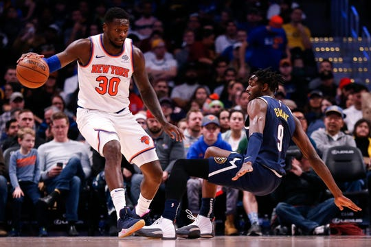 Dec 15, 2019; Denver, CO, USA; New York Knicks forward Julius Randle (30) controls the ball as Denver Nuggets forward Jerami Grant (9) falls to the floor in the second quarter at the Pepsi Center. Mandatory Credit: Isaiah J. Downing-USA TODAY Sportss