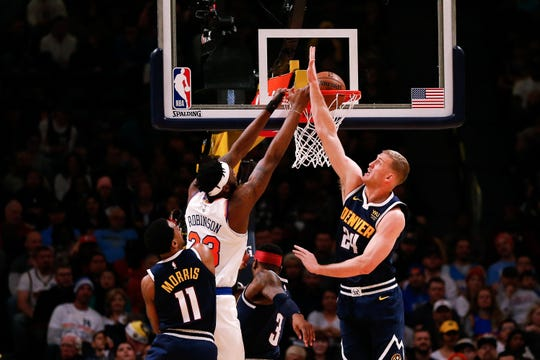 Dec 15, 2019; Denver, CO, USA; New York Knicks center Mitchell Robinson (23) dunks the ball as Denver Nuggets forward Mason Plumlee (24) and guard Monte Morris (11) defends in the first quarter at the Pepsi Center. Mandatory Credit: Isaiah J. Downing-USA TODAY Sportss