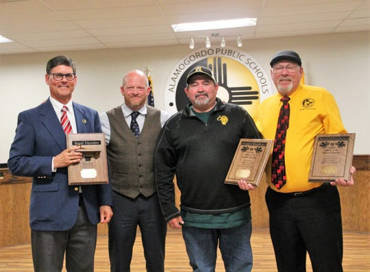 The Alamogordo Schools Board of Education saud goodbye to three board members who were leaving the board as of Dec. 31.  From left: APS Board President Timothy Wolfe, APS Superintendent Jerrett Perry, APS Board Member David Borunda and APS Board Member David Weaver.