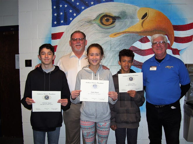 The Alamogordo Kiwanis Club is recognizing the Most Improved Student of the Month at Holloman Middle School. From left: sixth grader Christian Ingram, Principal Joe Keith, seventh grader Natalie Boyett, eighth grader Anthony Velez and Kiwanis Ned Kline