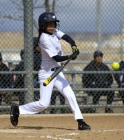 Piedra Vista's Fiona Delegarito (23) connects on a pitch for a 2-run RBI against Los Alamos during the Linda Crabtree Softball Challenge on Friday, March 7, 2014 at the Farmington Sports Complex in Farmington. The Lady Panthers won their ninth straight blue trophy in 2014.