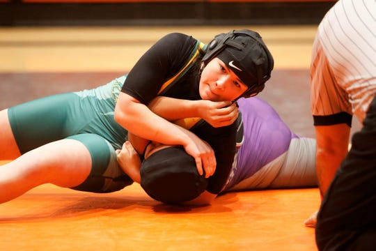 Gloria Ramos of Los Alamos pins Miyamura's Nizhoni Largo of Miyamura to the ground during a 143-pound division match at the first annual girls wrestling tournament on Friday, Jan. 25, 2019 at Lillywhite Gym in Aztec.