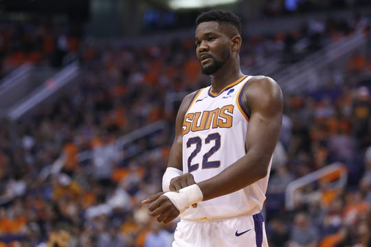 Suns center Deandre Ayton (22) looks on during the first half of a game against the Kings on Oct. 23 at Talking Stick Resort Arena.
