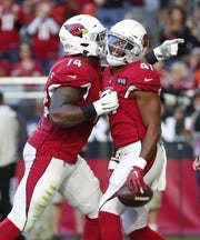 Arizona Cardinals running back Kenyan Drake (41) celebrates his touchdown run with offensive tackle D.J. Humphries (74) against the Cleveland Browns during the second quarter at State Farm Stadium December 15, 2019.