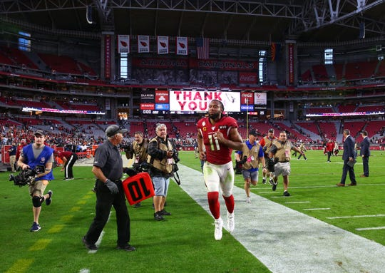 Arizona Cardinals wide receiver Larry Fitzgerald (11) runs to the locker room after defeating the Cleveland Browns during a game on Dec. 15, 2019 in Glendale, Ariz.