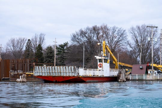 Champion's Auto Ferry is seen idle at the dock in Algonac Monday, Dec. 16, 2019, while crews work to repair the dock. The dock collapsed last Wednesday.