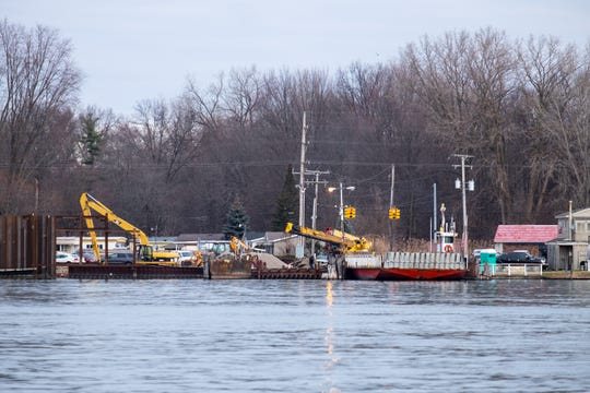 Champion's Auto Ferry is seen idle at the dock in Algonac Monday, Dec. 16, 2019, while crews work to repair the dock. The dock collapsed the previous week.