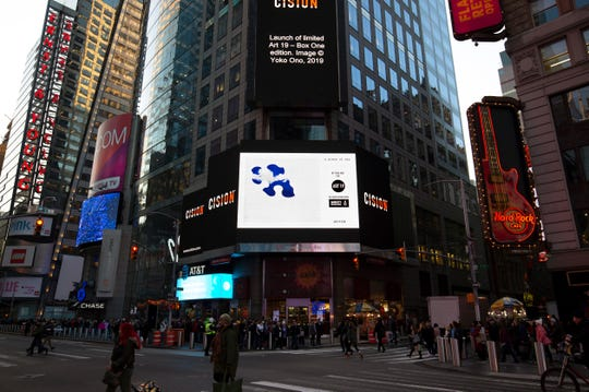 """""""A Piece of Sky"""" by Yoko One is displayed in Times Square as part of Amnesty International's Art 19 initiative."""