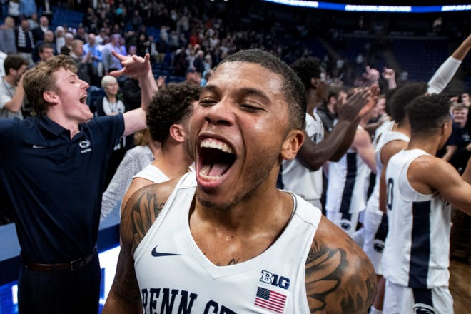 Penn State guard Myles Dread (2) celebrates with fans after the team upset Maryland 76-69 in an NCAA college basketball game in State College, Pa., Tuesday, Dec. 10, 2019. (AP Photo/Barry Reeger)