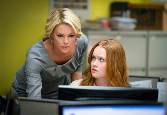 """Charlize Theron, left, and Liv Hewson star in """"Bombshell."""" The movie opens Thursday at Regal West Manchester."""