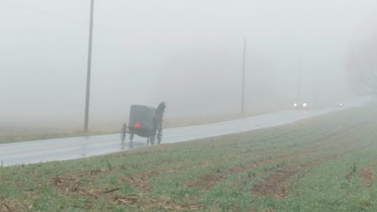A buggy travels along Bunker Hill Road near Strasburg.