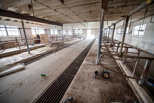 An empty dairy barn on the Beiler farm. Ivan Beiler is a mason and dairy production was no longer profitable.