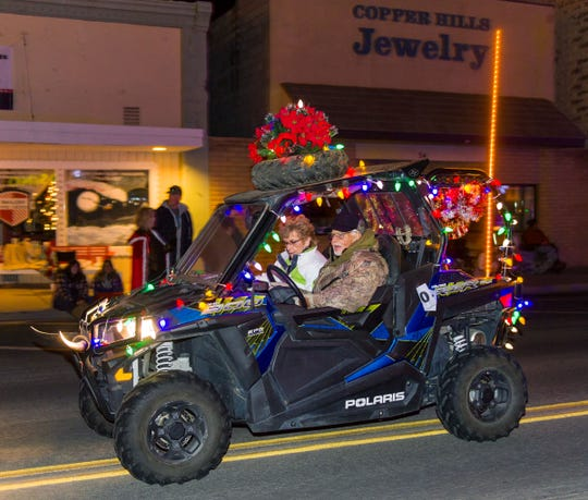 A colorfully-decorated off-road vehicle participates in the parade.