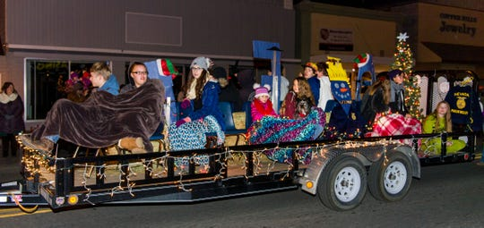 Members of the Mason Valley FFA ride on their float.