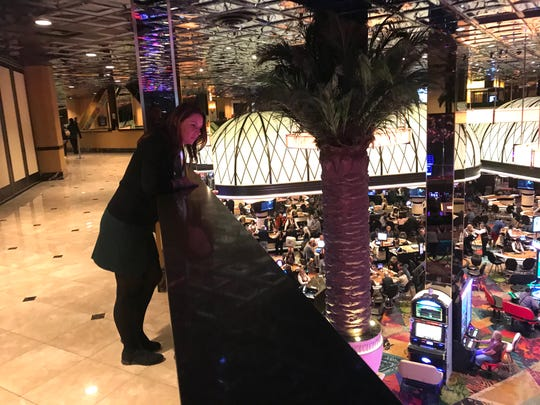 From a walkway above the Atlantis casino floor, beverage manager Holly Buchanan checks on bar staff, cocktail waitresses and the flow of beverage service.
