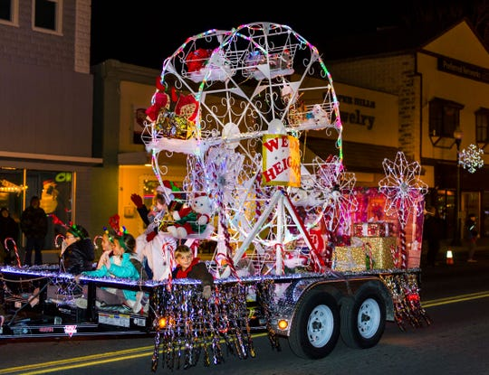 A Ferris wheel adorns the Weed Heights float.