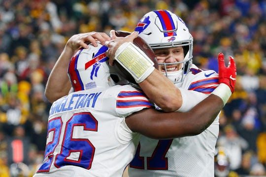 PITTSBURGH, PENNSYLVANIA - DECEMBER 15: Josh Allen #17 of the Buffalo Bills celebrates with Devin Singletary #26 after scoring a touchdown during the second quarter against the Pittsburgh Steelers in the game at Heinz Field on December 15, 2019 in Pittsburgh, Pennsylvania. (Photo by Justin K. Aller/Getty Images)