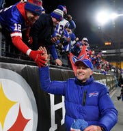 Buffalo Bills head coach Sean McDermott celebrates with fans after the Bills' 17-10 win over the Pittsburgh Steelers at Heinz Field clinched a playoff berth on Sunday night.