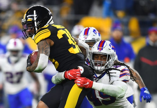 PITTSBURGH, PENNSYLVANIA - DECEMBER 15: Tremaine Edmunds #49 of the Buffalo Bills tackles Jaylen Samuels #38 of the Pittsburgh Steelers during the second half in the game at Heinz Field on December 15, 2019 in Pittsburgh, Pennsylvania. (Photo by Joe Sargent/Getty Images)