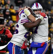 Buffalo Bills quarterback Josh Allen, right, celebrates with Devin Singletary after Allen's 1-yard touchdown run in the second quarter during Sunday night's game in Pittsburgh. The Bills won 17-10.