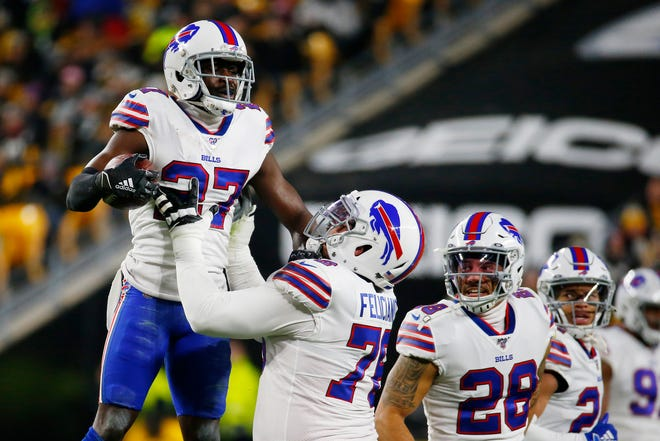 PITTSBURGH, PENNSYLVANIA - DECEMBER 15: Tre'Davious White #27 of the Buffalo Bills celebrates with teammates after intercepting a pass during the first quarter against the Pittsburgh Steelers in the game at Heinz Field on December 15, 2019 in Pittsburgh, Pennsylvania. (Photo by Justin K. Aller/Getty Images)
