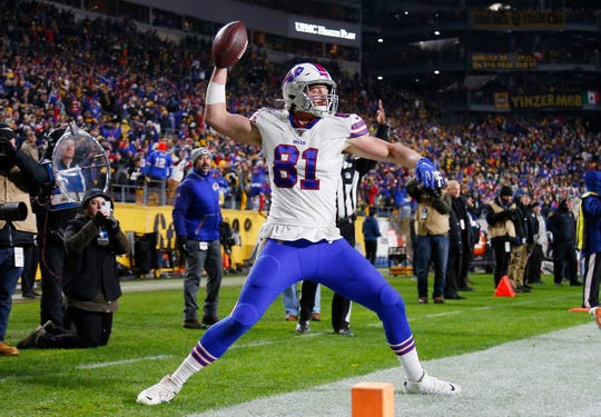 Tyler Kroft  of the Buffalo Bills celebrates scoring a touchdown during the fourth quarter against the Pittsburgh Steelers in the game at Heinz Field on December 15, 2019 in Pittsburgh, Pennsylvania.