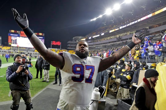Buffalo Bills defensive tackle Jordan Phillips (97) celebrates as he walks off the field following Sunday's win over the Steelers.