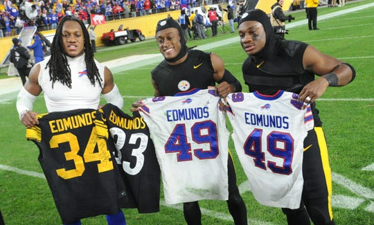 Brothers Tremaine Edmunds, Terrell Edmunds and Trey Edmunds spend a moment with each other after the Buffalo Bills defeated the Pittsburgh Steelers on Sunday night.
