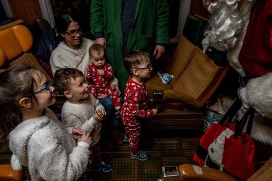 Reporter Victoria Freile's sons Luke, 15 months, and Joe, 3, with friends Charlotte Hunt, 5, and Nate Hunt, 3, of Irondequoit meet Santa on the Polar Express train in Utica on Dec. 15, 2019