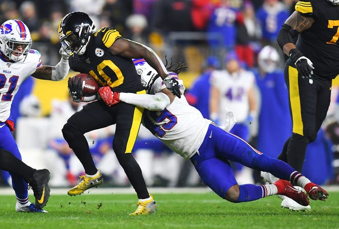 PITTSBURGH, PENNSYLVANIA - DECEMBER 15: Tremaine Edmunds #49 of the Buffalo Bills tackles Kerrith Whyte #40 of the Pittsburgh Steelers during the first half in the game at Heinz Field on December 15, 2019 in Pittsburgh, Pennsylvania. (Photo by Joe Sargent/Getty Images)