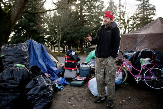 Anthony Stevens, 40, is living out of a tent near downtown Salem, Ore. A camping ban, aimed at clearing city sidewalks and other public property of homeless camps, officially went into effect Monday.