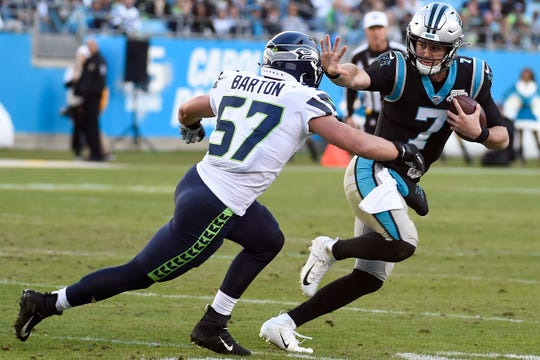 Seattle Seahawks linebacker Cody Barton (57) chases Carolina Panthers quarterback Kyle Allen (7) during the second half of an NFL football game in Charlotte, N.C., Sunday, Dec. 15, 2019.