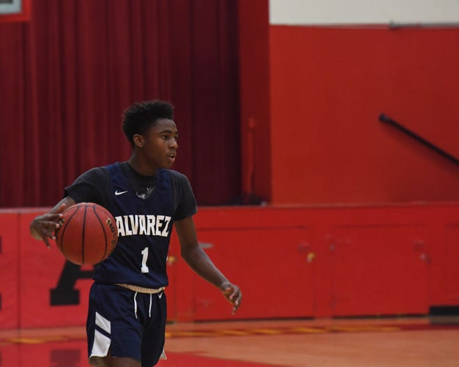 Everett Alvarez guard Jalen Brown (1) takes the ball past half court to initiate the offense. Dec. 13, 2019.