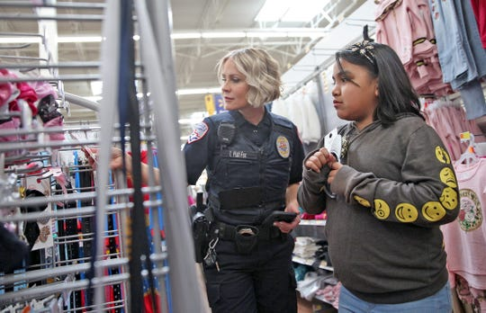 San Angelo Police Officer Tracy Piatt-Fox and Rebecca Samaniego shop at Walmart during the annual Blue Santa event Saturday, Dec. 14, 2019.