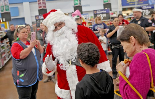 Santa Claus visits kids before the annual Shop with a Cop event Saturday, Dec. 14, 2019.