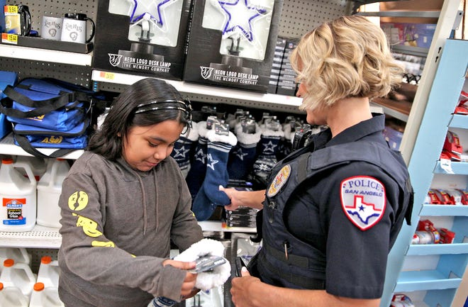 San Angelo Police Officer Tracy Piatt-Fox and Rebecca Samaniego shop at Walmart during the annual Blue Santa event Saturday, Dec. 14, 2019.