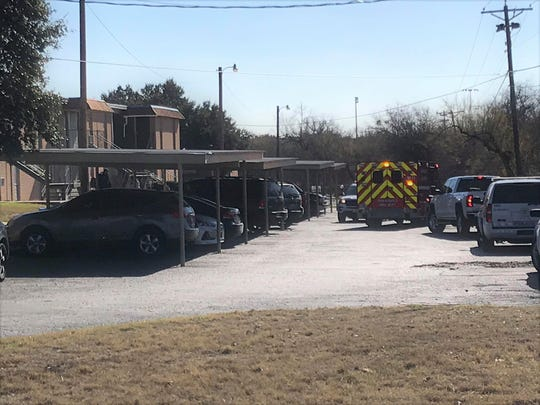 An ambulance stands parked outside Bella Vista Apartments in San Angelo on Monday afternoon, Dec. 16, 2019.