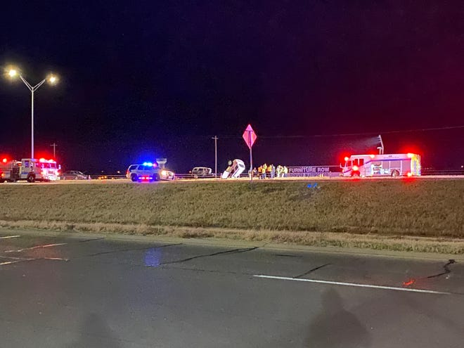 San Angelo police investigate a head-on crash that killed two people on Houston Harte Expressway in front of Furniture Row on Sunday, Dec. 15, 2019.