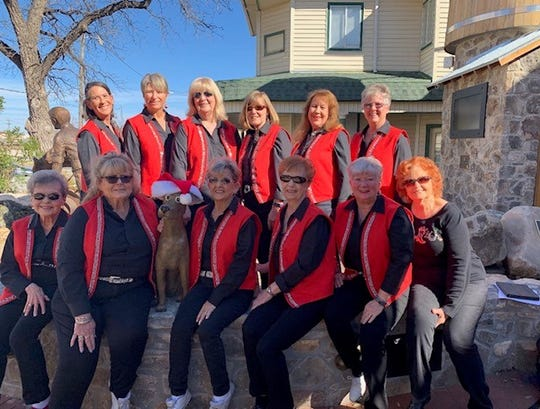 Cloggers from The Cowboy Church performed at the first Christmas in the Park event.