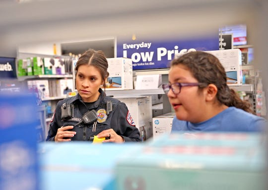 San Angelo Police Officer Kelsey Hernandez and Allyzzon Buzo shop at Walmart during the Blue Santa event Saturday, Dec. 14, 2019.