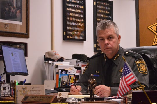Wicomico County Sheriff Mike Lewis sits behind his desk on Wednesday, Dec. 11, 2019.