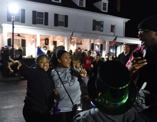 Families and friends dance on Somerset Avenue during the New Year's Eve Midnight Muskrat Dive in Princess Anne.