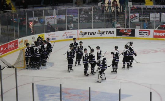 The Lone Star Brahmas celebrate their victory over Shreveport on George's Pond at Hirsch Coliseum on Saturday.